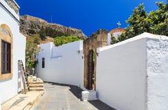 Entrada a la casa hermosa en Lindos, Rodas Día asoleado del verano fotos de archivo libres de regalías