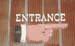 Entrance. Large entrance sign painted on tin roof Royalty Free Stock Photography