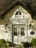 Entrance 1873. Typical northern german vintage home with thatched roof and beautiful entrance Royalty Free Stock Images
