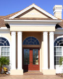 Entrance. To model home in suburbs, with tall columns and gabled roof royalty free stock image