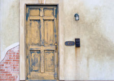Entrance. Old faded door with mailbox Royalty Free Stock Photography