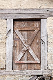 Entrance of an abandoned house with an old, wooden door Royalty Free Stock Images