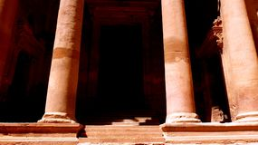 Entrance of Al Khazneh the treasury of Petra ancient city in Jordan stock photography