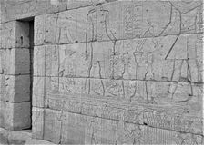 Entrance along wall of the Temple of Dendur with Osiris royalty free stock photos