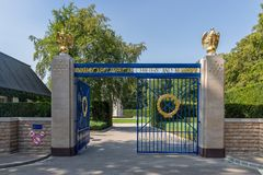 Entrance American WW2 Cemetery with iron gate and gold eagles. Hamm near Luxembourg city, Luxembourg - August 22, 2018: Entrance American WW2 Cemetery with iron royalty free stock images