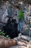 The entrance of the ancient cave in Thailand Stock Images