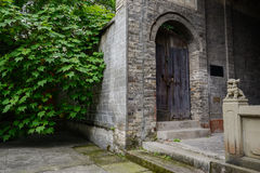 Entrance of ancient gray brick Chinese building Stock Photos