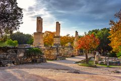 The entrance of ancient market agora with the ruins of the temple of Agrippa under the rock of Acropolis in Athens. Stock Photo