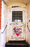 Entrance of antique building with graffiti Royalty Free Stock Image