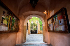 Entrance through the arch into a colorful courtyard of Catholic Cathedral Stock Photography