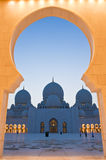 The entrance arch frames the Mosque Stock Photo