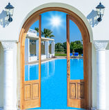Entrance arch palm view. Arch door with a column in a hotel in Palm Beach Resort Royalty Free Stock Photos