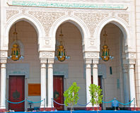Entrance Arches of a Dubai Mosque. The entrance to a Dubai Mosque with arches and ornate chandeliers Royalty Free Stock Photos