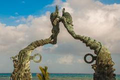 Entrance of the beach in Playa del Carmen, Mexico. Riviera Maya. Sculpture of a man and woman`s joined hands.  stock photo
