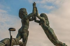 Entrance of the beach in Playa del Carmen, Mexico. Riviera Maya. Sculpture of a man and woman`s joined hands.  stock images