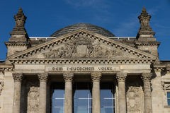 Entrance of Berlin's Reichstag. The dome was constructed by Sir Norman Foster, the entrance shows the inscription Dem Deutschen Volke (Dedicated to the German Royalty Free Stock Image