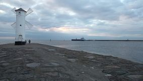 Entrance and breakwater to the port of Swinoujscie stock video
