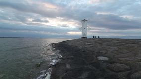 Entrance and breakwater to the port of Swinoujscie stock footage