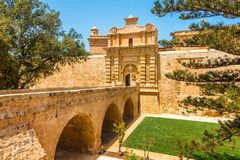 Entrance bridge and gate to Mdina. Stock Images