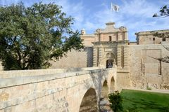 Entrance bridge and gate to Mdina, a fortified medieval city on Royalty Free Stock Photo