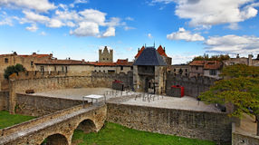 Entrance in Carcassone fortified town. Image of the Entrance in The Carcassonne as it is seen from the castle.Carcassonne is a very famous fortified medieval Stock Photo