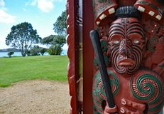 Entrance carving at Maori war canoe house Stock Images