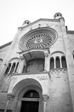 Entrance Cathedral of S. Maria Assunta in Modena. With rose window in Italy Royalty Free Stock Photo