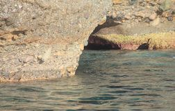 Entrance of a cave in the sea. The entrance of a cave in the sea Stock Photos