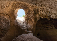 Entrance into the cave. Summer day Royalty Free Stock Images
