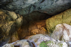 Entrance of a cave with underground river Stock Photo