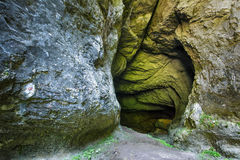 Entrance of a cave with underground river Stock Image