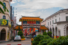 Entrance Chinese gate on the road in the city centre. Kuching Sarawak. Borneo Royalty Free Stock Image