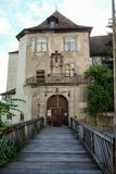 Entrance of a castle with a bridge in the foreground royalty free stock photo