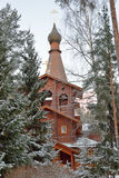 The entrance of the Church among the pine trees Royalty Free Stock Photos