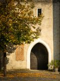 Entrance of the church of Spitz an der Donau on a sunny day in autumn royalty free stock images