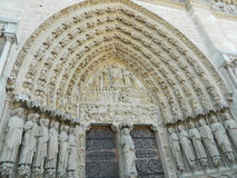 Entrance close-up of Notre Dame de Paris Cathedral, France. This cathedral is considered to be one of the finest examples of French Gothic architecture, and it Stock Photo