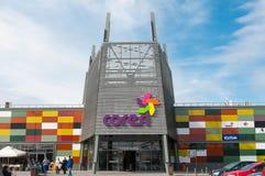 Entrance of Coresi mall , business logos, colorful glass. Modern aluminium construction Stock Photos