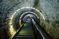 Entrance corridor in the salt mine Turda, Cluj, Ro. Visitors walking in the tunnel of the salt mine Turd, Cluj, Romania- stairs to the entrance Stock Image