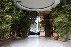 The Entrance. The cozy look of this entrance is decorated with plants of Japanese bamboo and on the ceiling of a circle design Stock Images