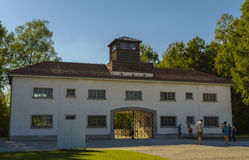 Entrance of Dachau concentration camp. Arbeit macht frei gate with unidentified people who visit the concentration camp on August 29, 2015 in Dachau, Bavaria Stock Photos
