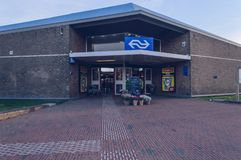 Entrance of Den Helder train station with lighting boxes and flower sale. Den Helder, The Netherlands, October 13, 2018: Entrance of Den Helder train station stock photo