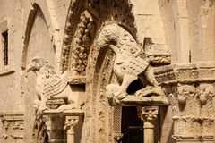 Entrance detail. Cathedral. Ruvo di Puglia. Apulia. Italy. Detail. Griffins guarding the Entrance, Romanesque Cathedral. Ruvo di Puglia. Apulia. Italy royalty free stock image