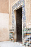 Entrance door at the Alhambra Palace. Granada, Andalusia, Spain with intricate relief stone carving and inlaid patterned tile surround Stock Photography