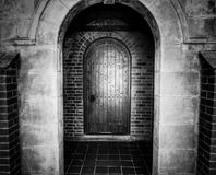 Entrance door with arch in black and white Royalty Free Stock Photos