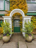 Entrance door in the autumn leaves Stock Photo