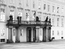 Entrance door with balcony to the Archives of Prague Castle on Third Courtyard, Prague, Czech Republic. Black and white image royalty free stock photography
