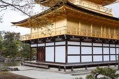 Entrance door in building of Kinkaku-ji temple the Golden Pavilion. Kinkaku ji shrine is in summer in Kyoto, Japan. Entrance door in building of Kinkaku-ji Royalty Free Stock Photos