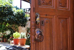 Entrance door close-up with knocker Royalty Free Stock Image