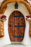 Entrance door of cob house. Entrance door of a clay and cob house stock photo