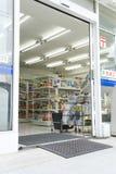 Entrance door of convenience store stock photo